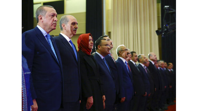 The Latest: Erdogan honors those killed opposing coup