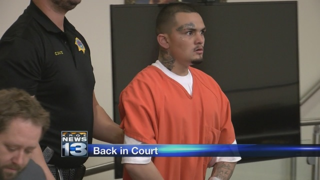 Man accused of trying to carjack football players to remain behind bars