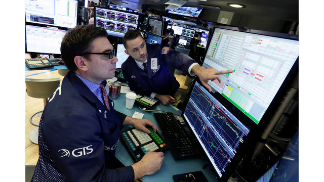 Dow ends bruising session 2.3% lower on trade war fears