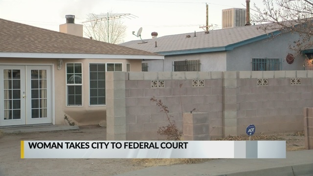 Albuquerque woman sues for right to live in home without water, power